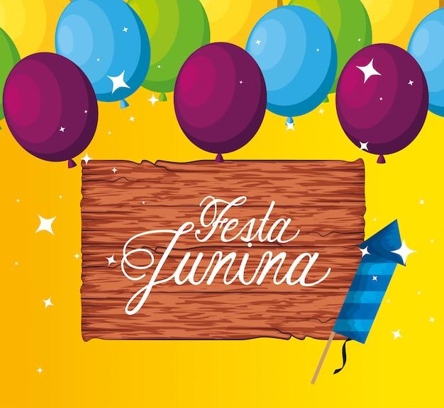 Emblema de madeira com decoração de balões e fogos de artifício