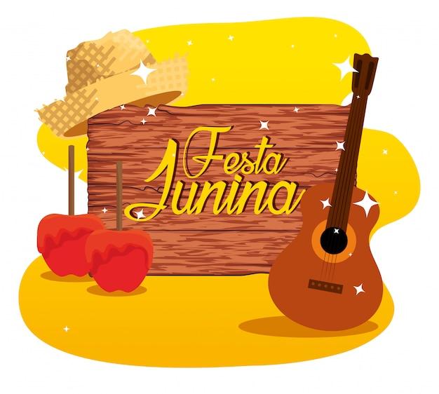 Emblema de madeira com maçãs e violão