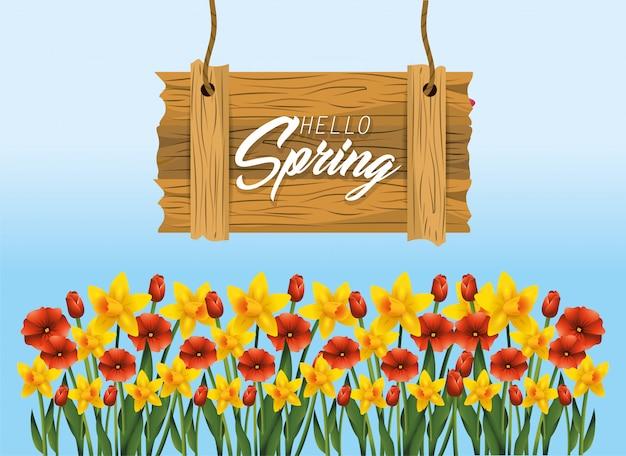 Emblema de madeira de primavera com plantas de flores exóticas