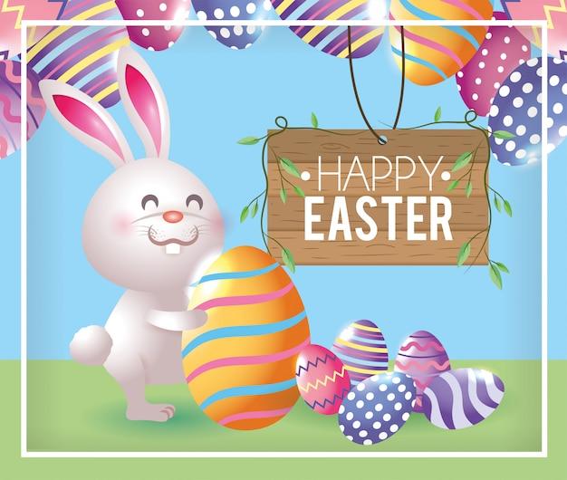 Emblema de madeira e coelho com decoração de ovos