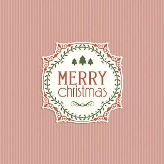 Emblema do natal em um fundo rosa listras