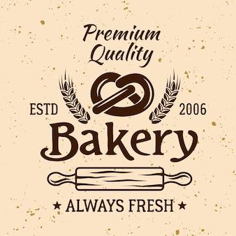 Emblema, etiqueta, crachá ou logotipo de vetor vintage de padaria com pretzel e rolo de massa em fundo de cor clara