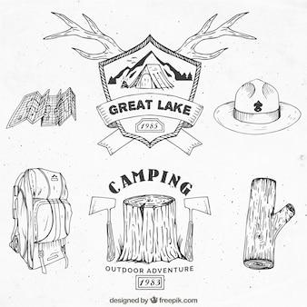 Emblemas aventura esboços e acessórios