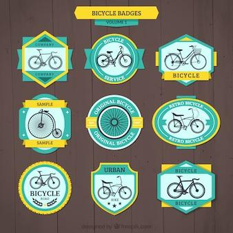 Emblemas bicicleta do vintage com detalhes amarelos