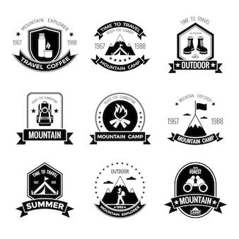 Emblemas pretos do acampamento da montanha