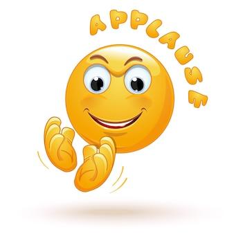 Emoji alegre batendo palmas alegremente