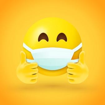 Emoji com máscara na boca e polegares para cima