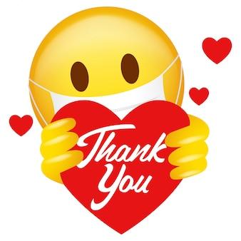 Emoticon usando máscara médica segurando o símbolo do coração com uma mensagem de agradecimento