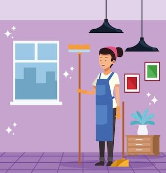 Empregada doméstica com vassoura e pá de lixo
