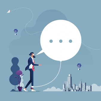 Empresário acorrentado e algemado a um grande conceito de compromisso de bolha-negócios