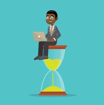 Empresário africano sentado na ampulheta.