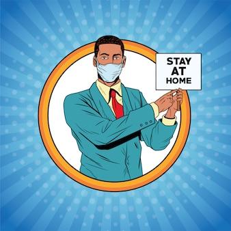 Empresário afro usando máscara facial para covid19 com banner estadia em casa
