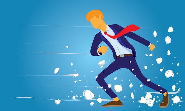 Empresário andando através do forte vento do desafio