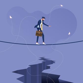 Empresário andando em uma corda bamba acima de um crack-negócios superando dificuldades