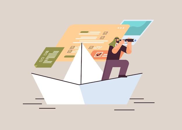 Empresário árabe com binóculos flutuando no barco de papel à procura de sucesso futuro liderança estratégia de inicialização conceito de planejamento horizontal ilustração vetorial de corpo inteiro