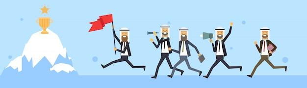 Empresário árabe pular bandeira iceberg vencedor copo prêmio fundo sucesso nos negócios conceito desafio risco bandeira