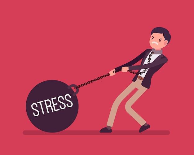 Empresário arrastando um peso stress na cadeia