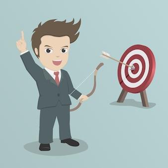 Empresário atirar uma flecha para mirar.