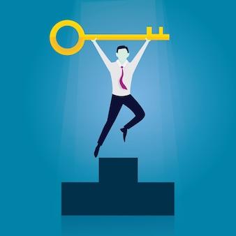 Empresário com chave do sucesso