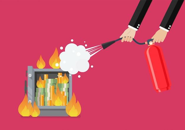 Empresário com extintor de incêndio está lutando com o cofre de metal em chamas