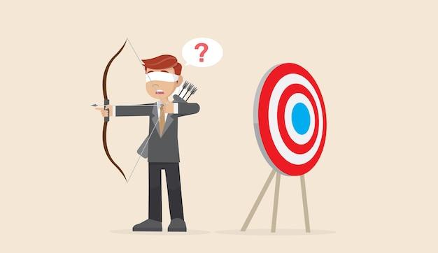 Empresário de olhos vendados atirando a flecha.