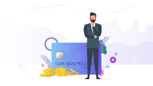 Empresário de sucesso com dinheiro. cartão de crédito, moedas de ouro, dólares.