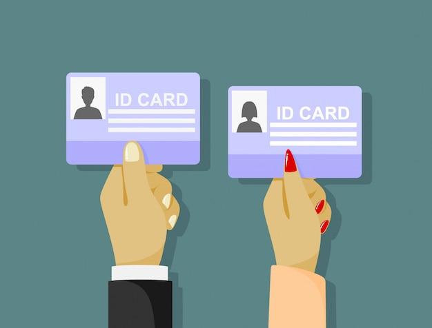 Empresário dos desenhos animados mão segurando o cartão de identificação.