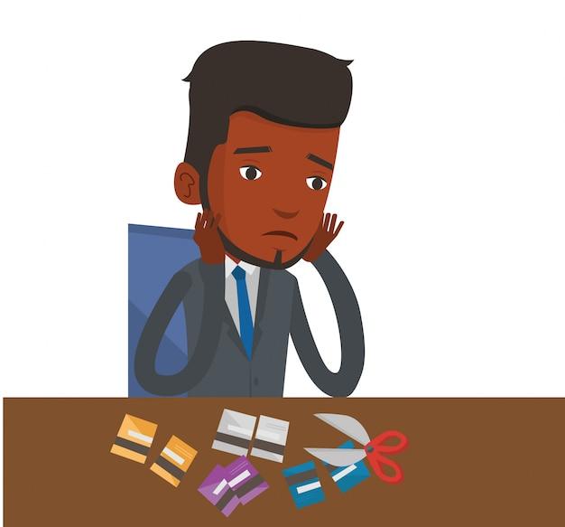 Empresário falido cortando seu cartão de crédito.