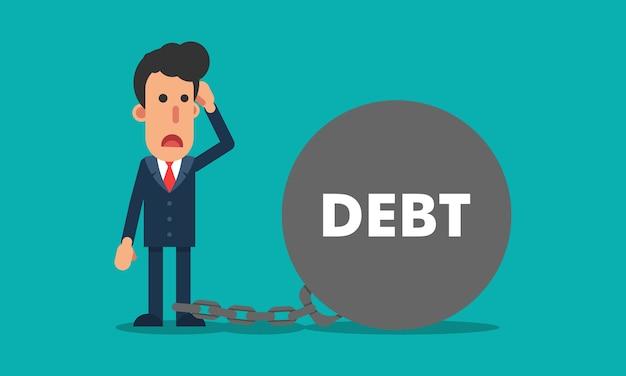 Empresário hispânico acorrentado com bola de dívida grande