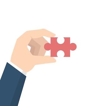 Empresário mão segurando o quebra-cabeça. conceito de problema e solução.