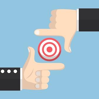 Empresário mãos formando um quadro e foco no alvo