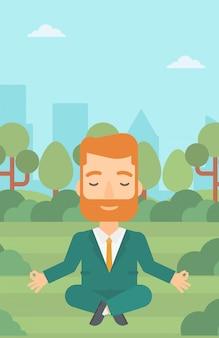 Empresário, meditando em pose de lótus.