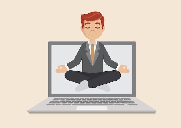 Empresário meditando no laptop.
