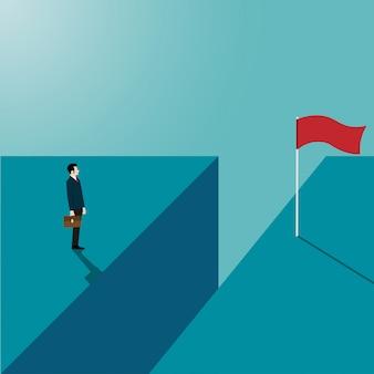 Empresário olhando alcançar o outro lado da falésia