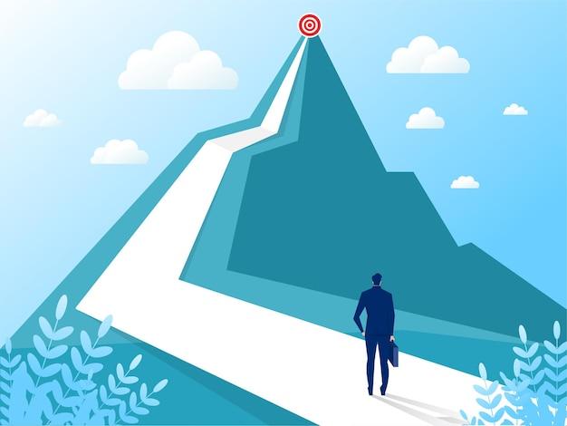 Empresário olhando para a montanha. visão e cumprimento de metas