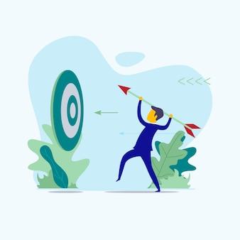 Empresário para mirar um alvo com flecha