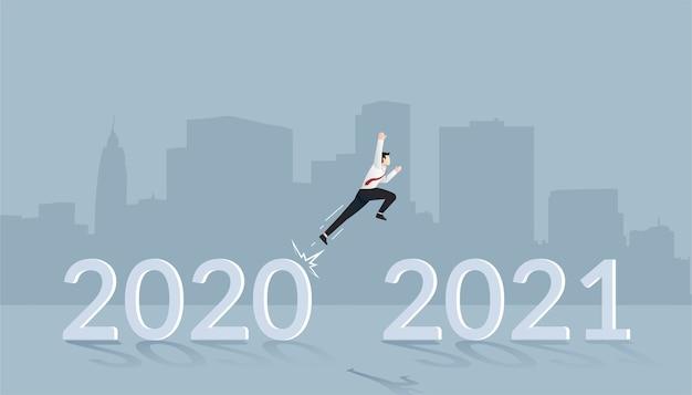 Empresário pulando no conceito de ano novo para uma nova visão e planejamento