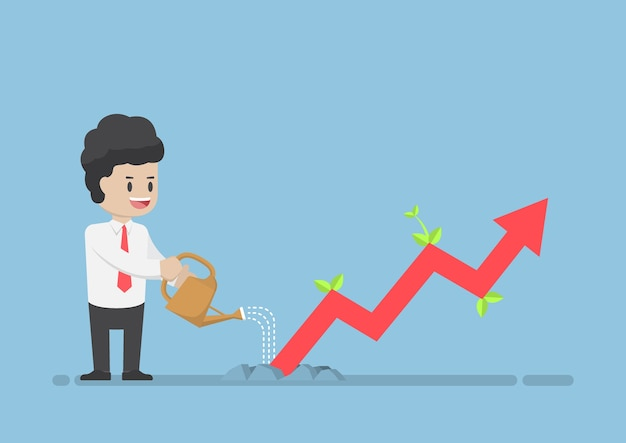 Empresário regando o gráfico de negócios que o crescimento através da terra