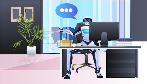 Empresário robótico sentado no local de trabalho no escritório, bate-papo, bolha, comunicação, inteligência artificial, conceito de tecnologia