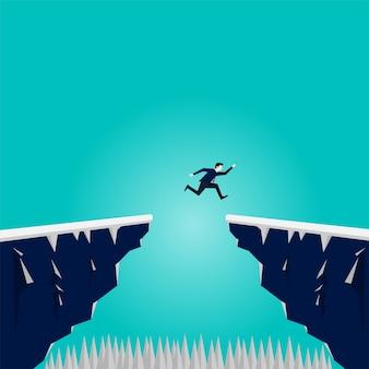 Empresário saltar sobre o fosso da montanha do penhasco