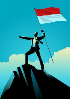 Empresário segurando a bandeira da indonésia no topo da montanha