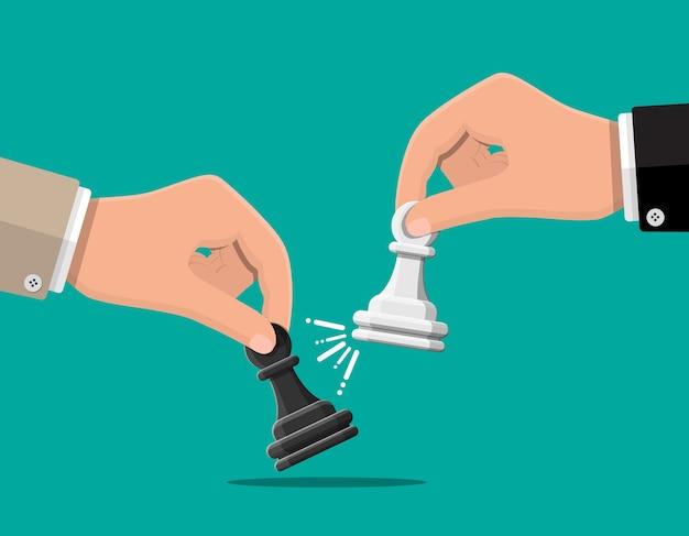 Empresário segurando na mão a figura de xadrez pwan. definição de metas. objetivo inteligente. alvo de negócios, competição, conceito de gestão. realização e sucesso.