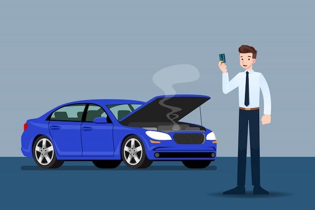 Empresário segurando um cartão de crédito na frente do carro quebrado.