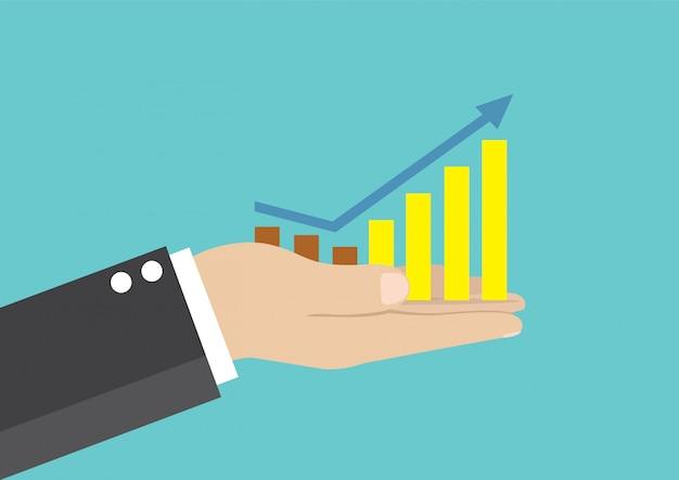 Empresário segurando um gráfico de negócios