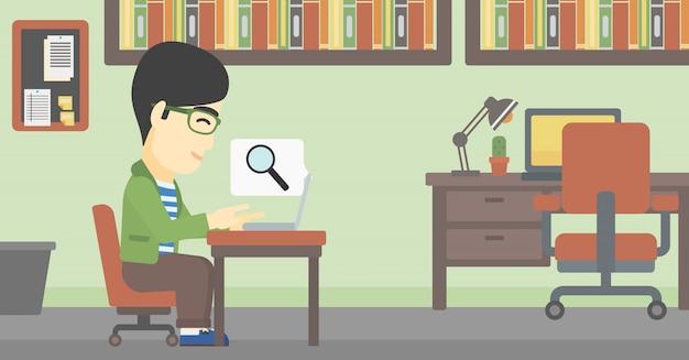 Empresário, trabalhando em seu laptop.