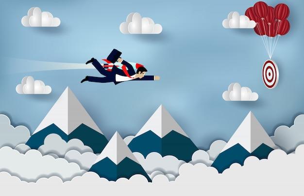 Empresário voando com motores de foguete para a frente para o objetivo de alcançar o sucesso