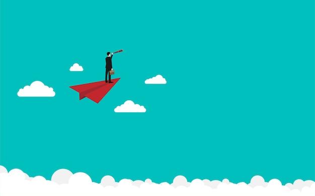 Empresário voando em um avião de papel vermelho