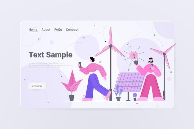 Empresários segurando lâmpada de luz turbinas eólicas painéis solares alternativa renovável verde economia de energia ecologia proteção ambiental