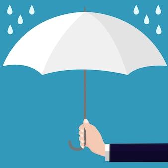 Empresários segurando o guarda-chuva branco aberto