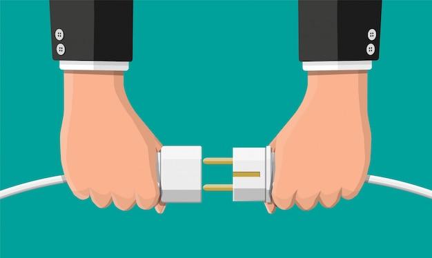 Empresários segurar plug e tomada na mão.